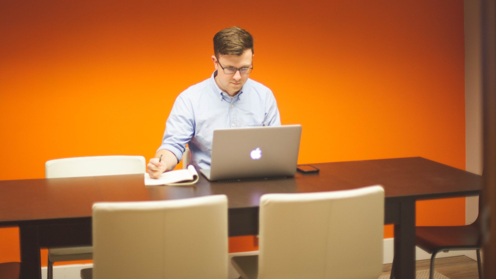 Man working in empty conference room