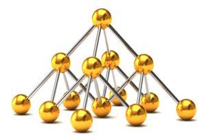 Imagine of a pyramid shape made from silver tubes and golden balls symbolizing a computer network