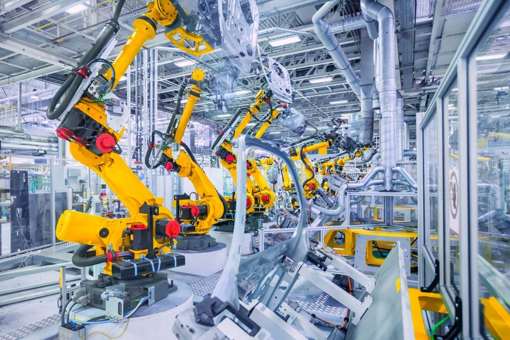 Photo of a factory floor featuring bright yellow equipment - CMIT Solutions of Gilbert and Mesa provides IT services that make the work day in your facility a whole lot easier