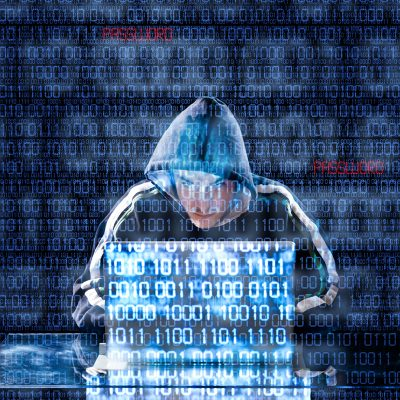 hacker with laptop - image overlaid with binary code -- cmit solutions of gilbert and mesa protects your business against hacking and ransomware