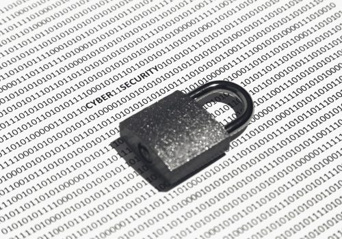 A closeup shot of a lock on a white surface with cyber security, ones, and zeros written on it