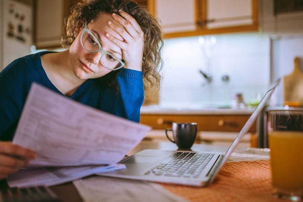 Woman  mulling over her taxes