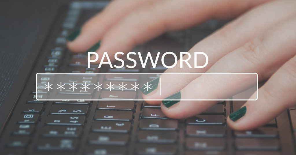 Picture of fingers on a keyboard entering a password