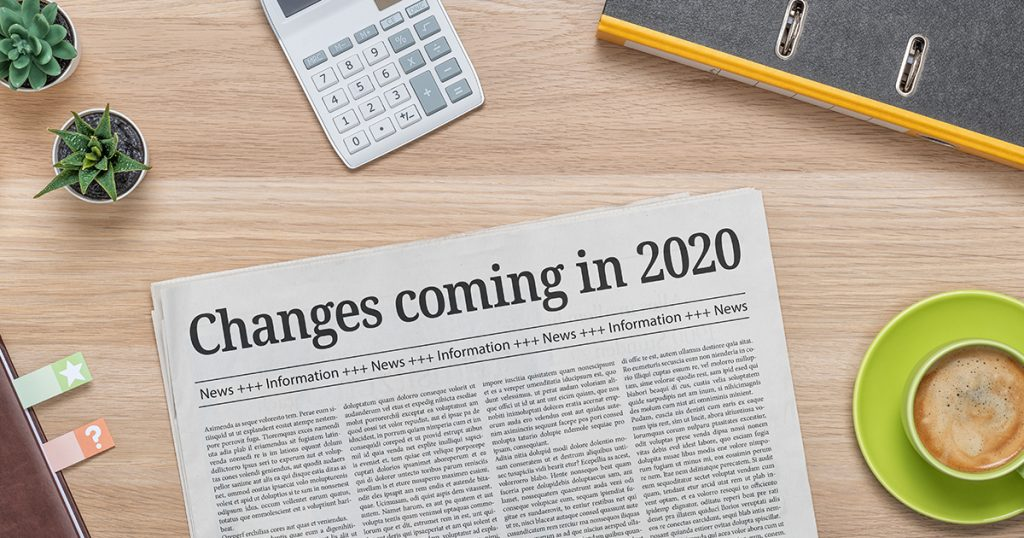 """Newspaper on a desk with the headline, """"Changes coming in 2020"""""""
